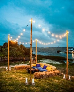 evening-lakeside-wedding-lounge-with-hay-bale-seating-and-string-lighting