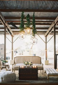 rustic-chic-lounge-area-with-couches-benches-and-geometric-chandeliers